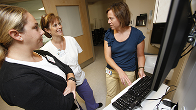 nurse leader conversing with colleagues