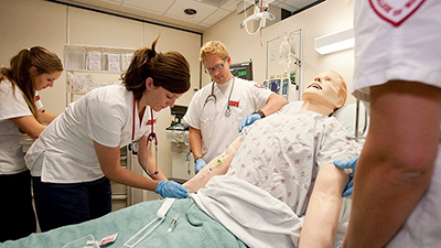nurses training with dummy patient