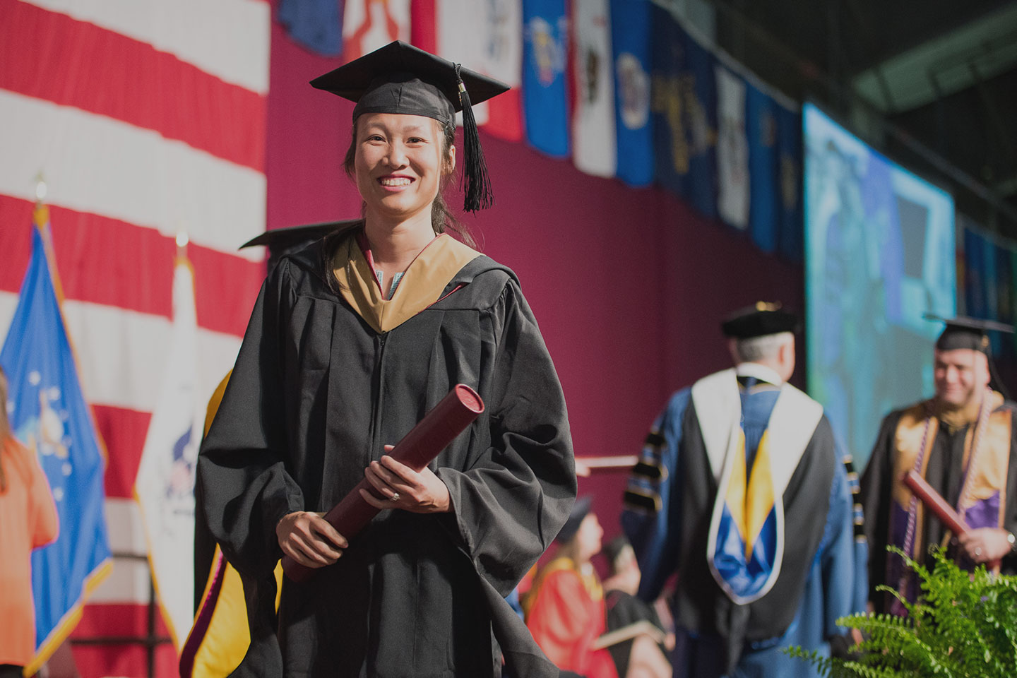 graduate on stage at 2018 commencement