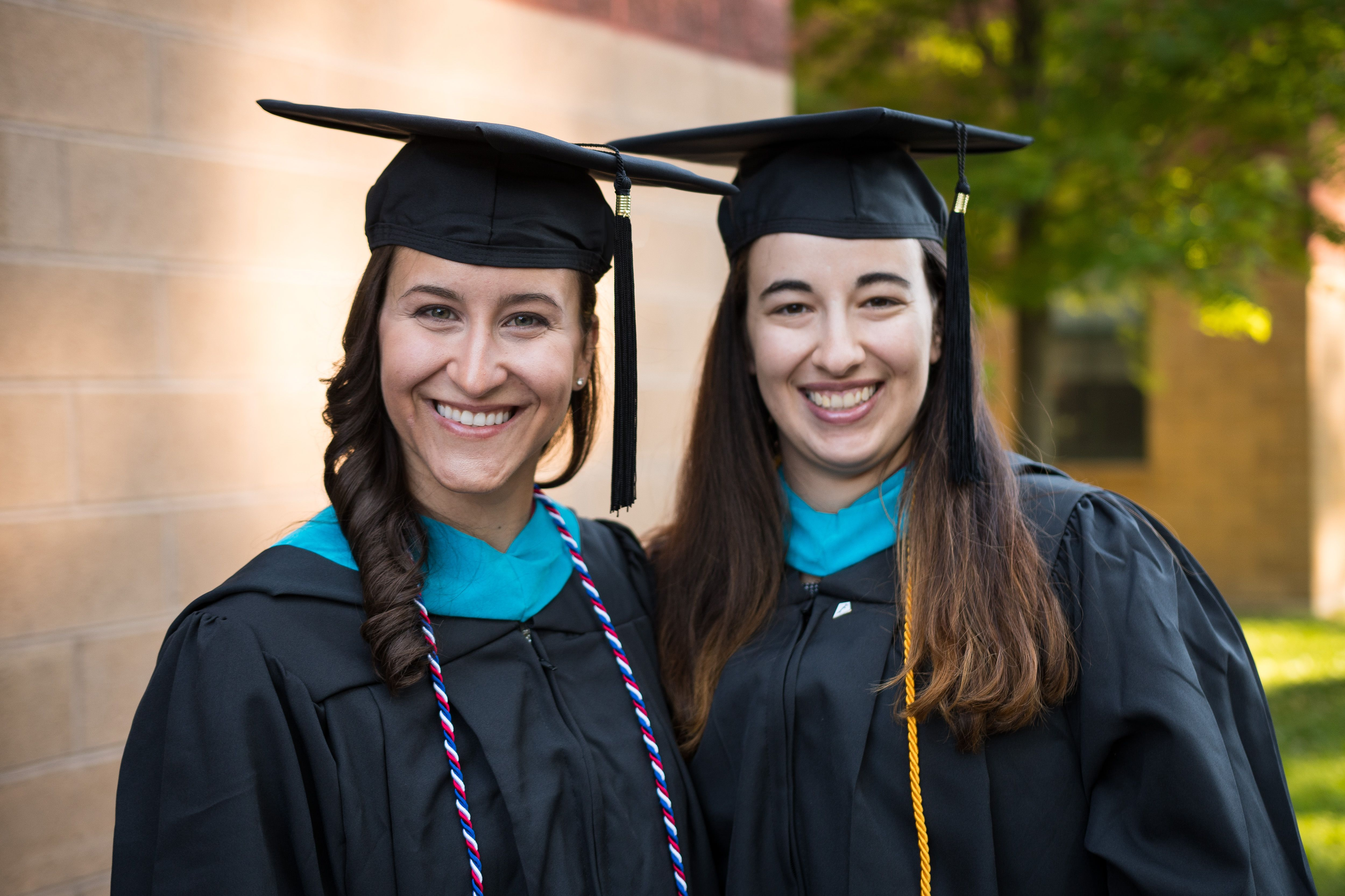 two female graduating students