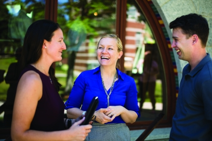three adult students on Norwich University campus