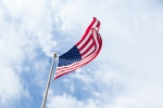US flag waving, sky as background