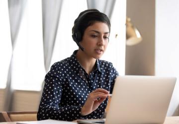 A graduate student taking a class online.