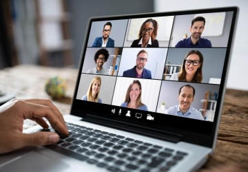 A virtual team meeting on a laptop screen.