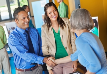 A job fair participant meets with an employer