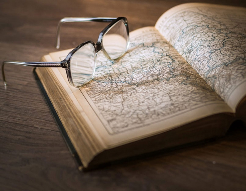 open books, pair of glasses