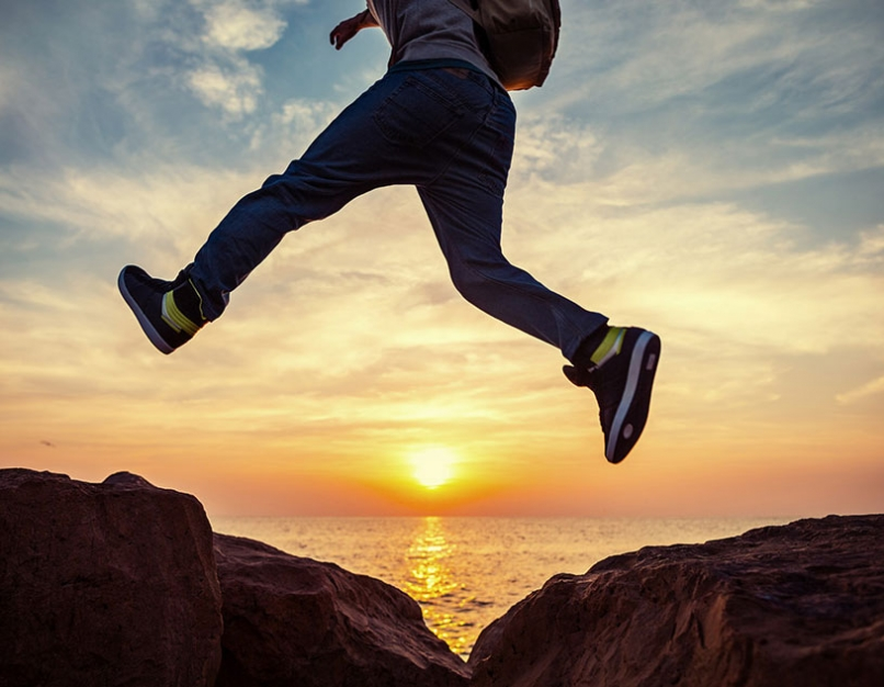 sunset, person jumping rocks