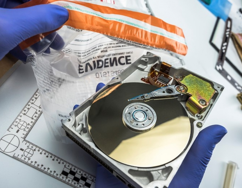 Computer forensics investigator analyzes a suspect's hard drive obtained in evidence.