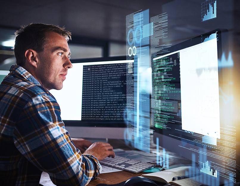 Man reading computer screen