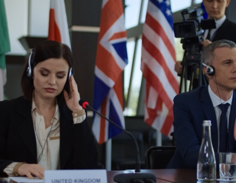 International summit delegates listen to an address.