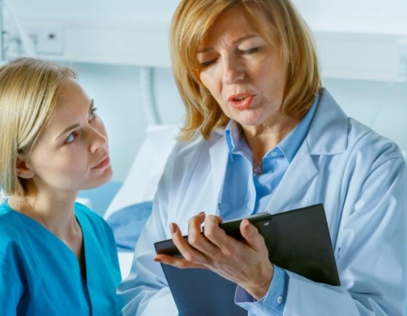 Nurse educator discussing patient chart with nursing student