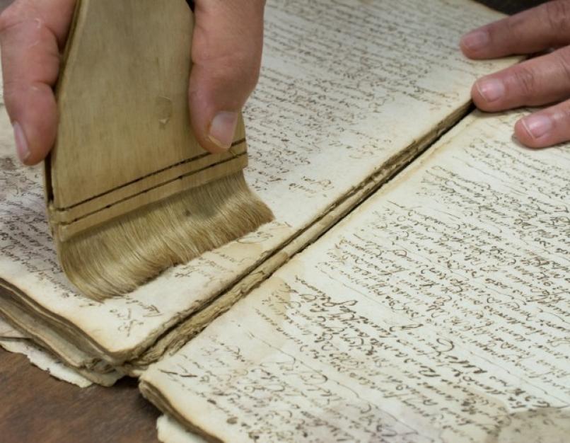 An archivist restoring a book.