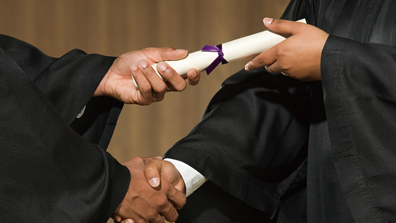 handshake to receive a diploma